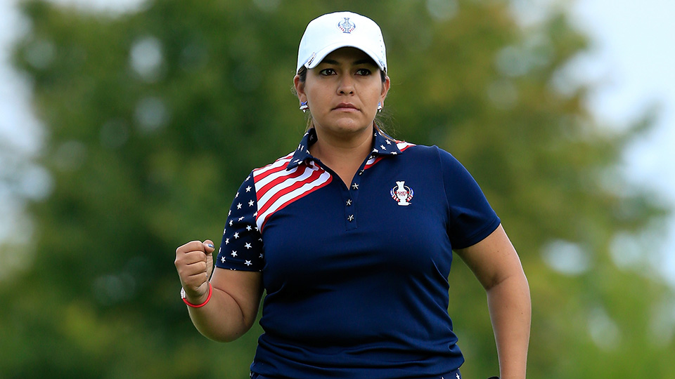 Lizette Salas holes a birdie putt at the 13th hole in her match against Azahara Munoz during the final day singles matches of the 2015 Solheim Cup.