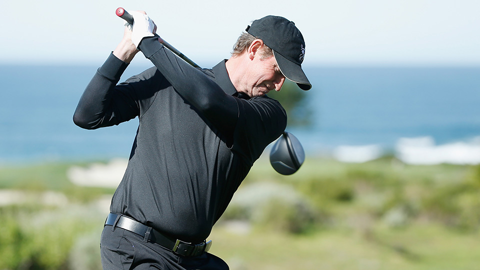 Hockey legend Wayne Gretzky hits a shot in practice for the AT&T Pebble Beach National Pro-Am at the Monterey Peninsula Country Club on February 11, 2015 in Pebble Beach, California.