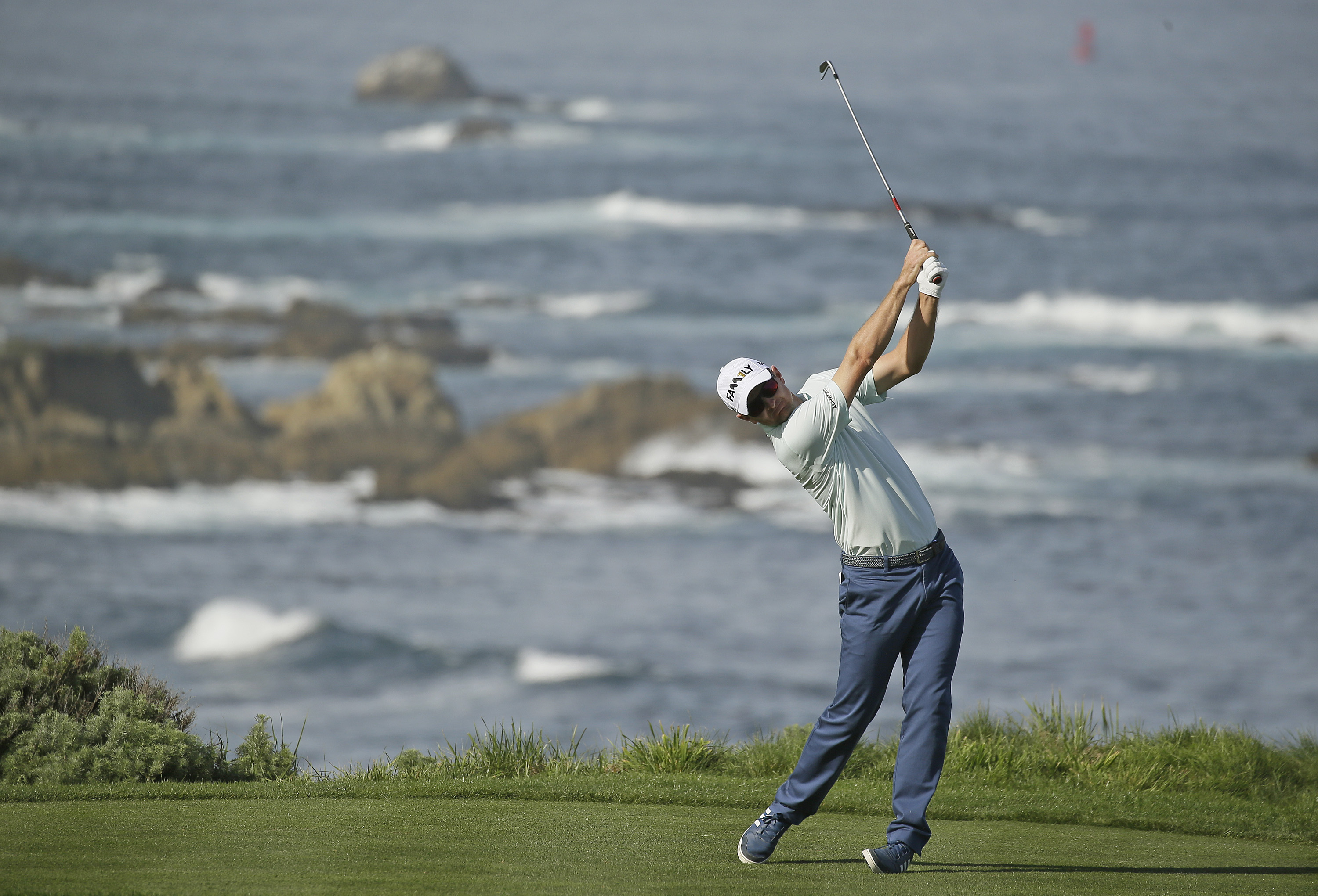 Justin Rose follows his shot from the fourth tee of the Spyglass Hill Golf Course during the first round of the AT&T Pebble Beach National Pro-Am golf tournament Thursday, Feb. 11, 2016, in Pebble Beach, Calif. (AP Photo/Eric