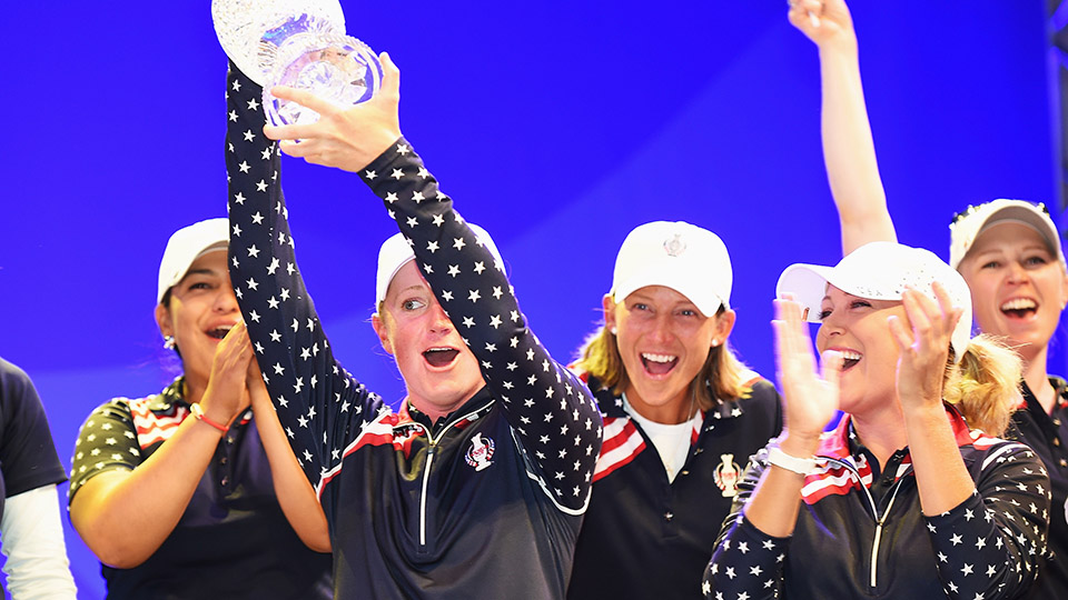 Stacy Lewis hoists the Solheim Cup at last year's closing ceremony.