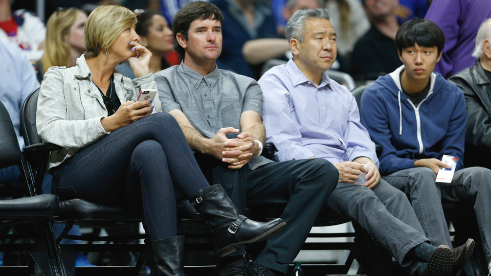 Bubba Watson and his wife, Angie (left), watch the Los Angeles Clippers and Golden State Warriors at Staples Center on Feb. 20, 2016, in Los Angeles.