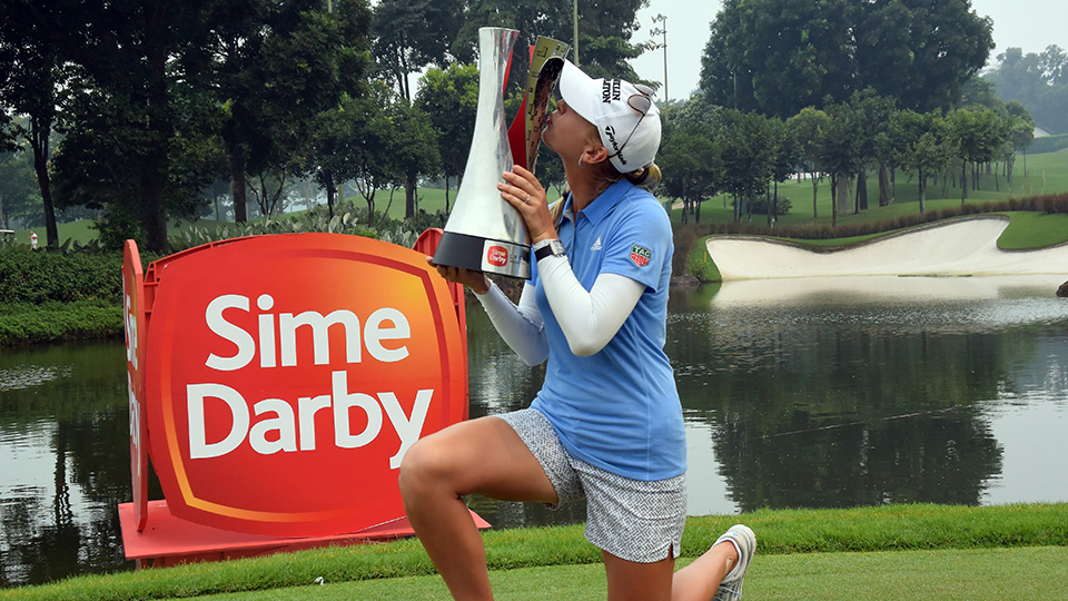 Jessica Korda of USA kisses the 2015 Sime Darby LPGA Tour trophy during the presentation ceremony after the final round of the 2015 Sime Darby LPGA Tour.
