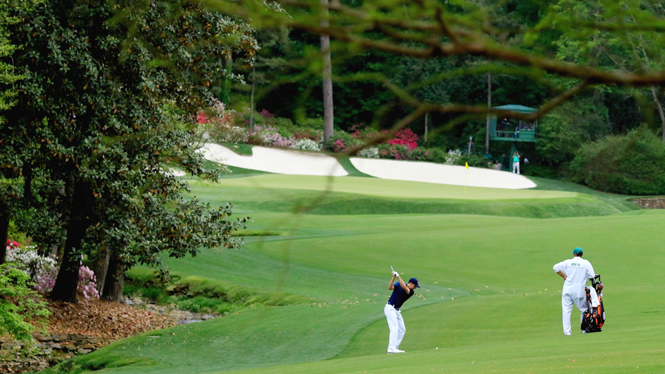 Jordan Spieth hits an approach on the 13th fairway during the final round of the 2015 Masters.