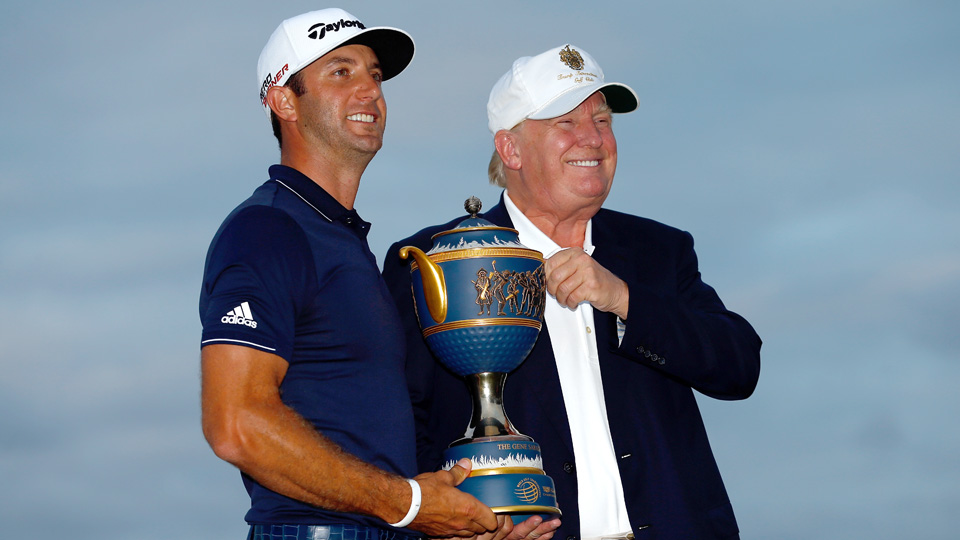 Dustin Johnson and Donald Trump pose with the Gene Sarazen Cup after Johnson won the World Golf Championships-Cadillac Championship at Trump National Doral in 2015.