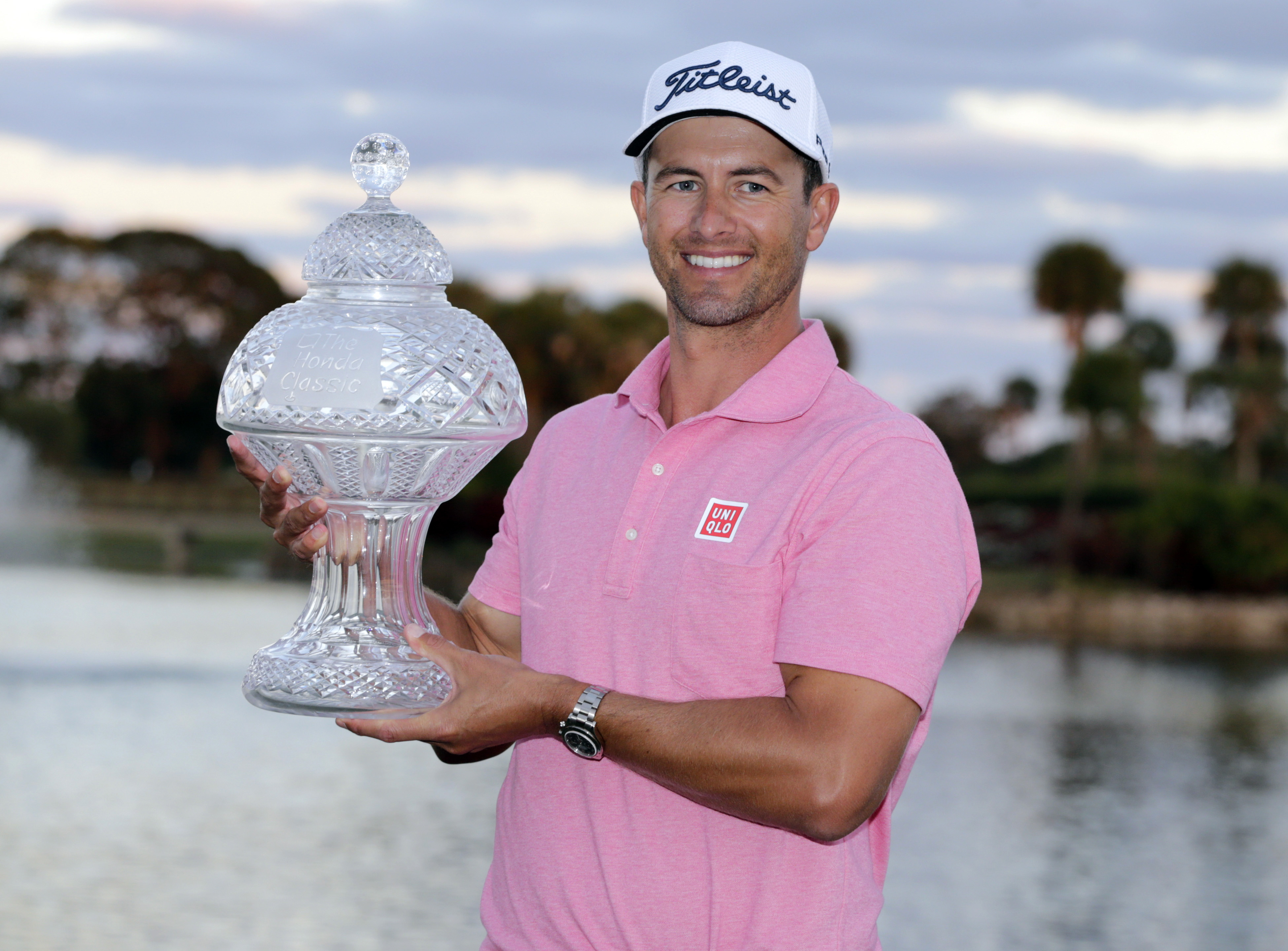 Adam Scott, of Australia, holds the trophy after winning the Honda Classic golf tournament with a 9-under-par, Sunday, Feb. 28, 2016, in Palm Beach Gardens, Fla. (AP Photo/Lynne