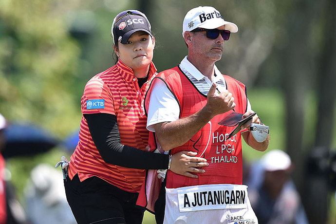 Ariya Jutanugarn of Thailand hugs her caddy during day one of the 2016 Honda LPGA Thailand at Siam Country Club on February 25, 2016 in Chon Buri, Thailand.