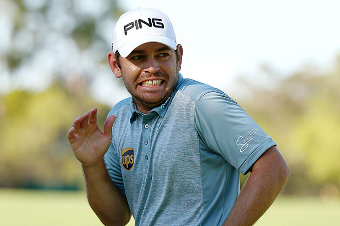 Louis Oosthuizen of South Africa reacts after throwing his ball into the gallery on the 18th green during day four of the 2016 Perth International at Karrinyup GC on February 28, 2016.