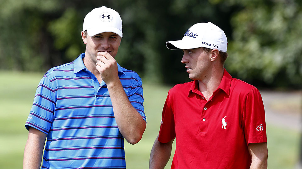 Jordan Spieth talks to Justin Thomas on the second green during the Third Round of the 2015 BMW Championship.