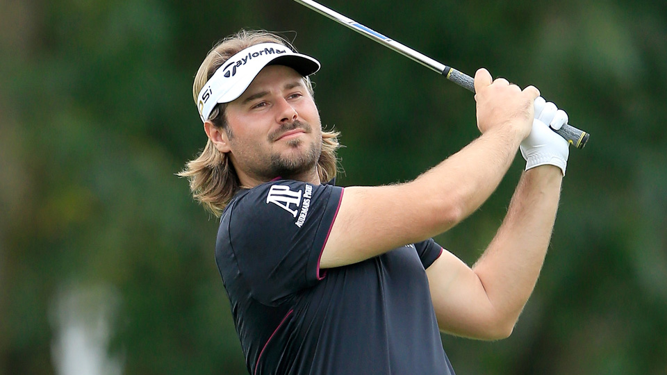 Victor Dubuisson plays his second shot on the second hole during the third round of the 2016 WGC-Cadillac Championship.