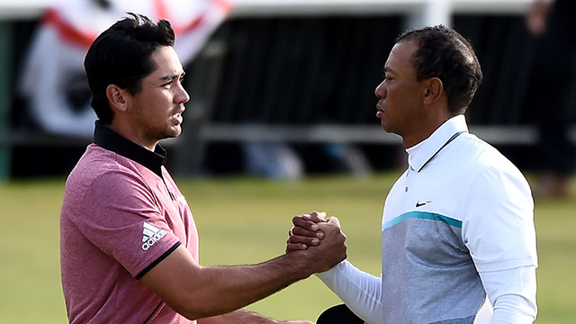 Jason Day and Tiger Woods shake hands on the 18th green during the second round of the 144th Open Championship.