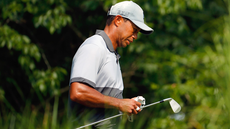 Tiger Woods walks up the 13th fairway during the third round of the Wyndham Championship at Sedgefield Country Club on August 22, 2015, in Greensboro, North Carolina.