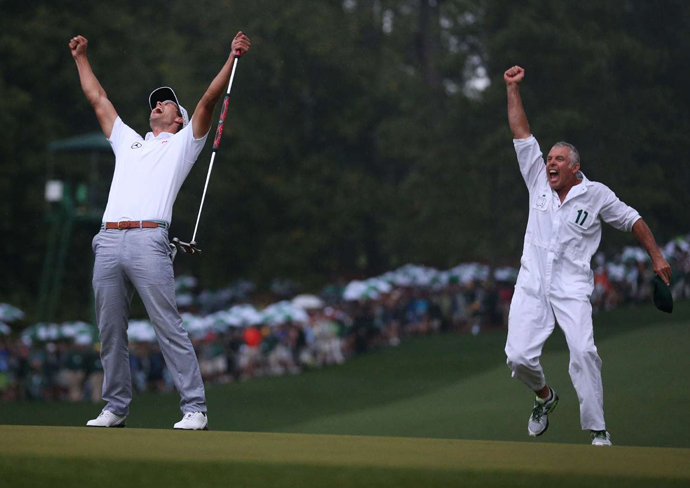 Adam Scott and caddie Steve Williams celebrate on the 10th hole, after Scott sunk a birdie putt in a playoff against Angel Cabrera to win the 2013 Masters.