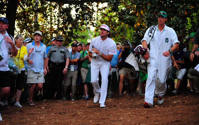 Bubba Watson hits a recovery shot from the pine straw en route to winning his first green jacket, which he did by triumphing on the second playoff hole, the 10th, against Louis Oosthuizen.
