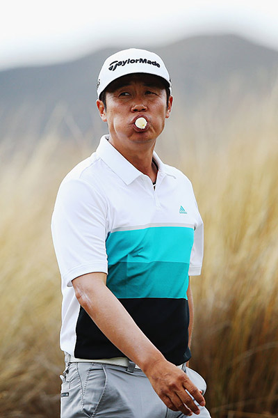 I J Jang of Korea eats a banana during day four of the 2016 New Zealand Open at The Hills.