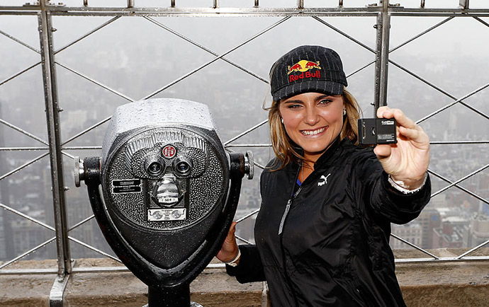 Seven-time LPGA winner Lexi Thompson takes a 'selfie' after participating in the lighting ceremony for the Empire State Building on March 14, 2016 in New York City.