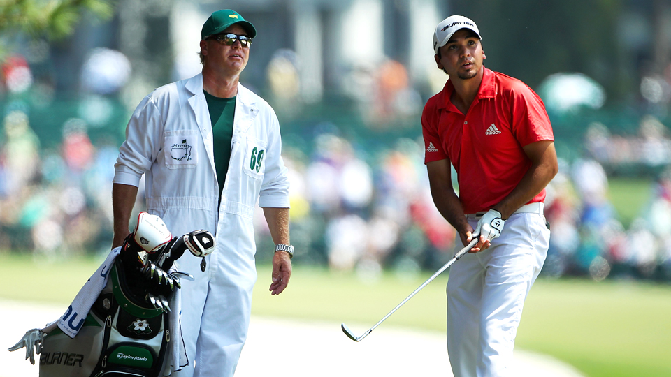 Jason Day chats with caddie Colin Swatton on the first hole during the final round of the 2011 Masters.