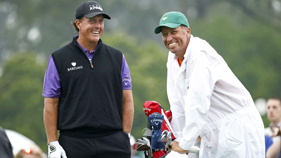 "Phil Mickelson and caddie Jim ""Bones"" Mackay wait to tee off on the 1st hole during a practice round for the Masters at Augusta National Golf Club in 2015."