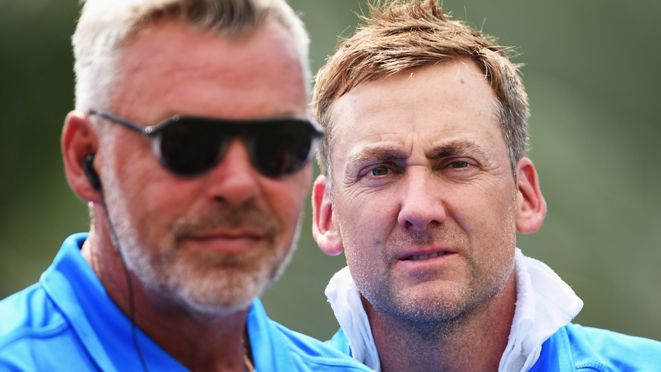 Darren Clarke (left) and Ian Poulter look on during the EurAsia Cup in January 2016.
