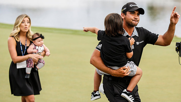 Jason Day of Australia celebrates his one stroke victory with his son Dash, wife Ellie and daughter Lucy on the 18th hole green during the final round of the Arnold Palmer Invitational presented by MasterCard at Bay Hill Club and Lodge