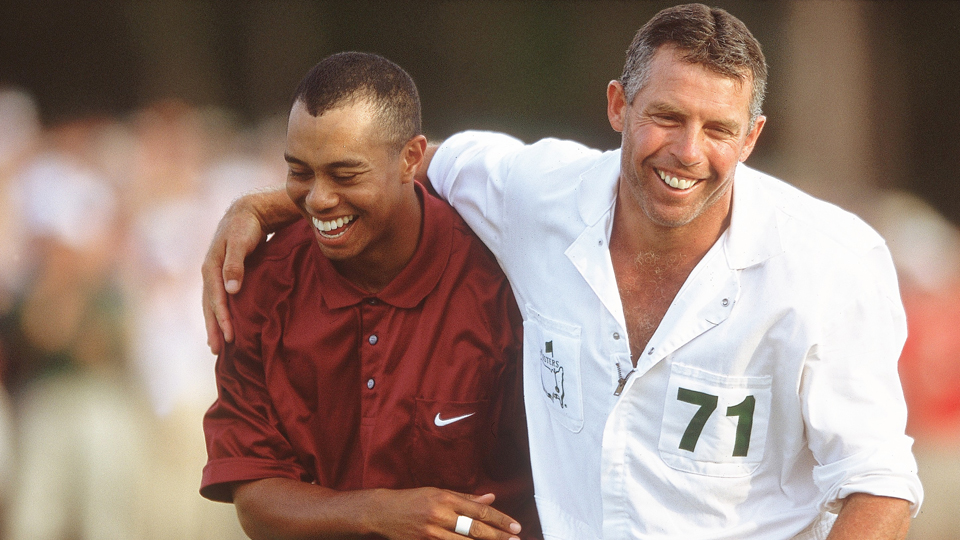 Tiger Woods and Steve Williams walk off the 18th green on Sunday of the 2001 Masters.