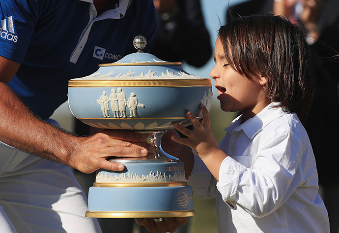 Jason Day of Australia shares the Walter Hagen Cup with his son Dash after defeating Louis Oosthuizen of South Africa 5&4 in the championship match of the World Golf Championships-Dell Match Play at the Austin Country Club on March 27, 2016 in Austin, Texas.