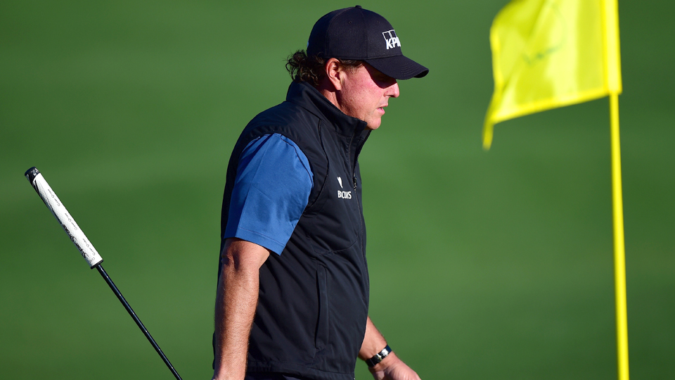 Phil Mickelson walks with his putter during a practice round prior to the start of the Masters at Augusta National Golf Club on April 5, 2016, in Augusta, Georgia.