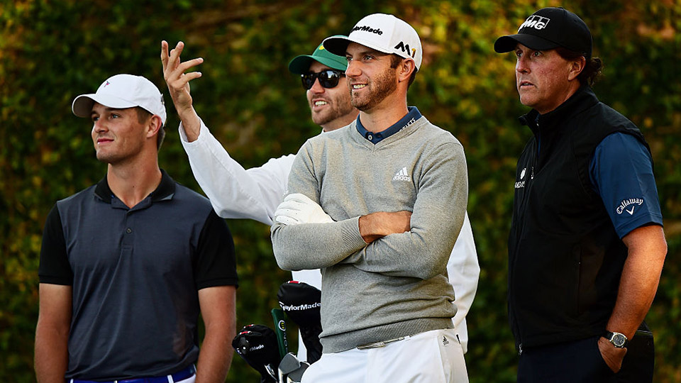 Dustin Johnson of the United States, Bryson DeChambeau of the United States and Phil Mickelson of the United States stand on the second tee during a practice round prior to the start of the 2016 Masters Tournament at Augusta National Golf Club