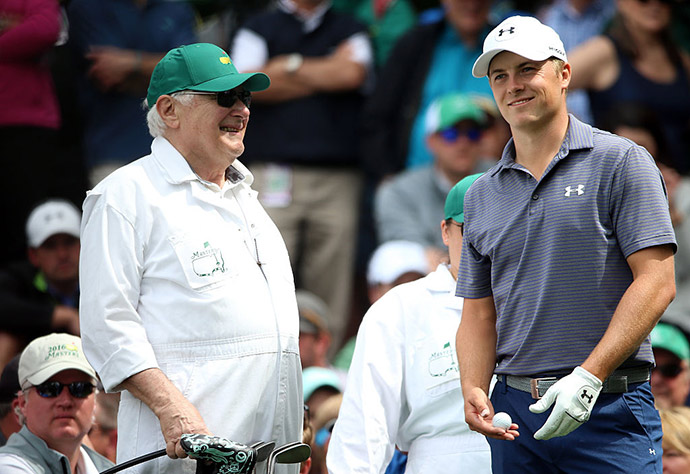 Jordan Spieth of the United States and grandfather Donald look on during the Par 3 Contest.