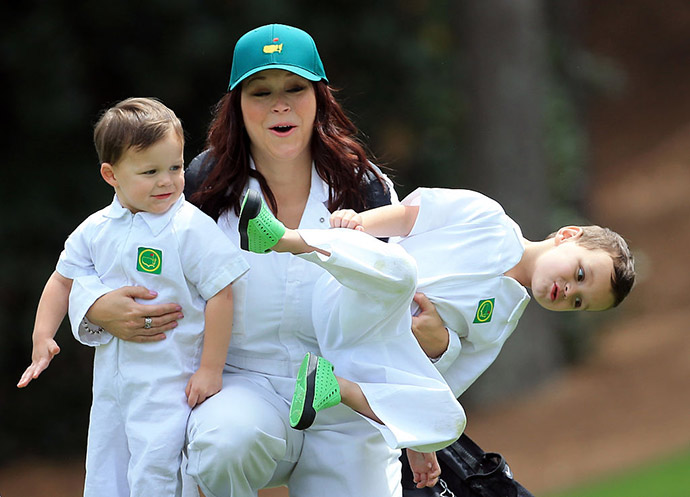 Wife of Marc Leishman of Australia, Audrey Hills and their sons Oliver and Harvey attend the Par 3 Contest.