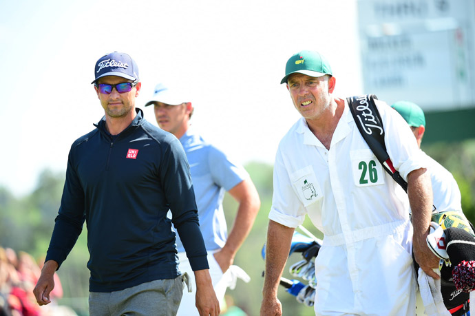 Adam Scott with caddie Steve Williams. Scott didn't fare well, shooting a 76.