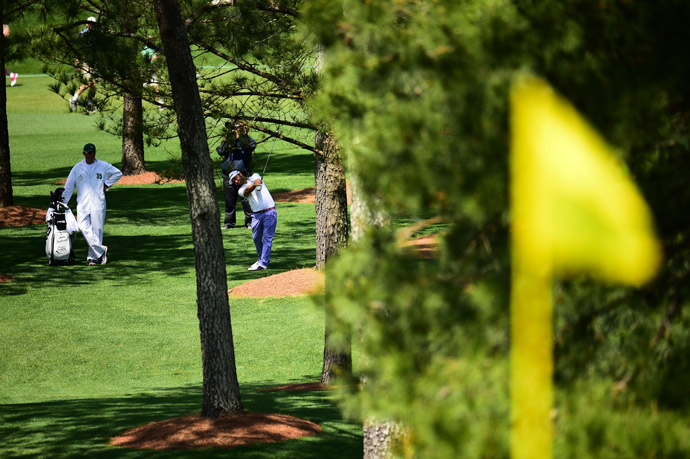 Andy Sullivan hits through the trees out of the rough on the 7th.