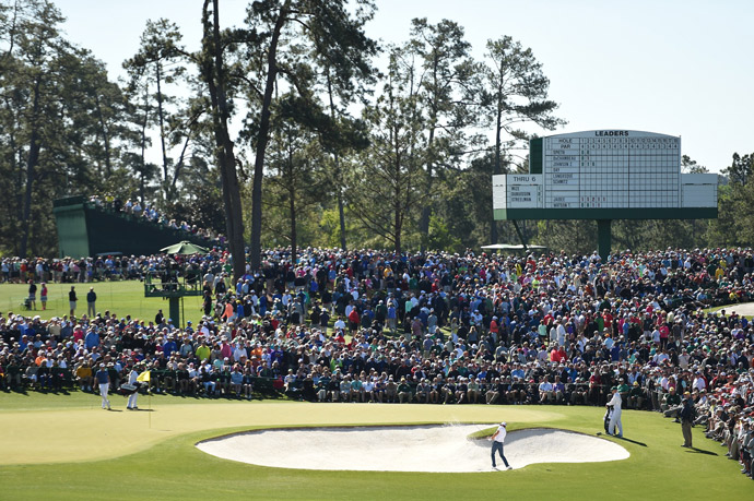 Large crowds watch Dustin Johnson play the 2nd hole.