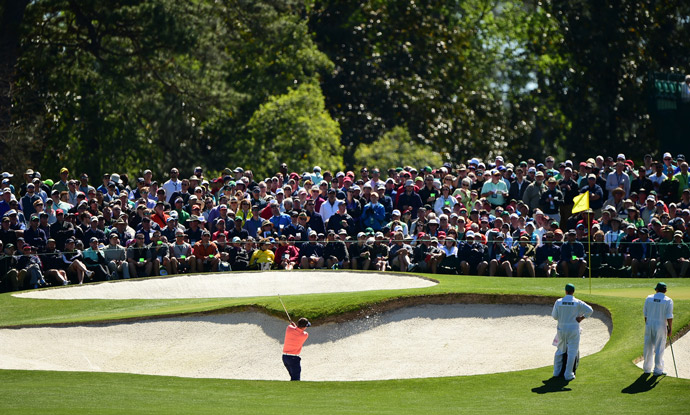 Jason Dufner hits out of a greenside bunker on Thursday.