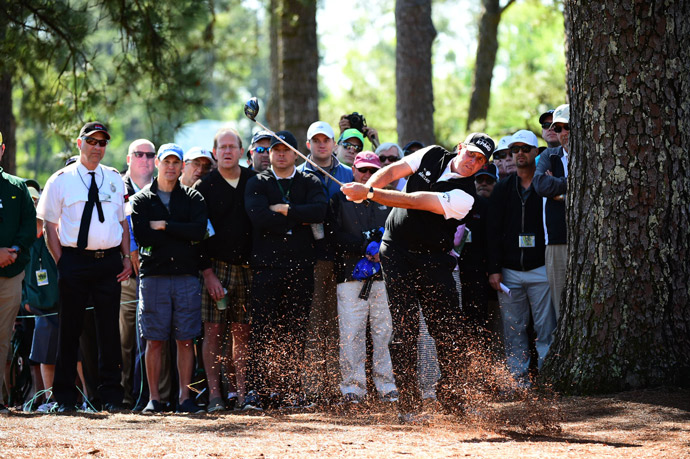 Mickelson hits out of the pine straw.