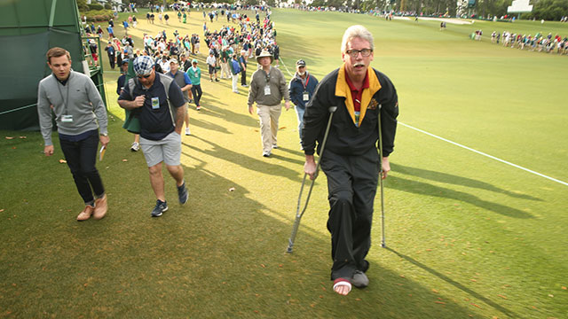 Brazell crutches up the first fairway on Friday morning.