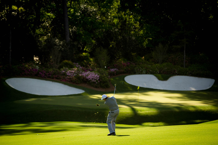Two-time Masters champion Phil Mickelson plays his second shot at the 13th during the second round.