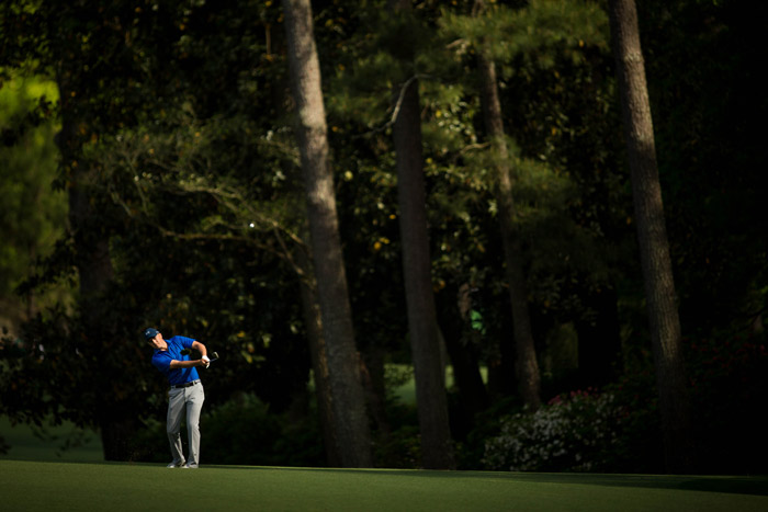 Defending champion Jordan Spieth plays his second shot at the 13th during the second round.