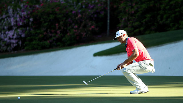 Dustin Johnson of the United States reacts to his putt on the 13th green during the final round of the 2016 Masters.