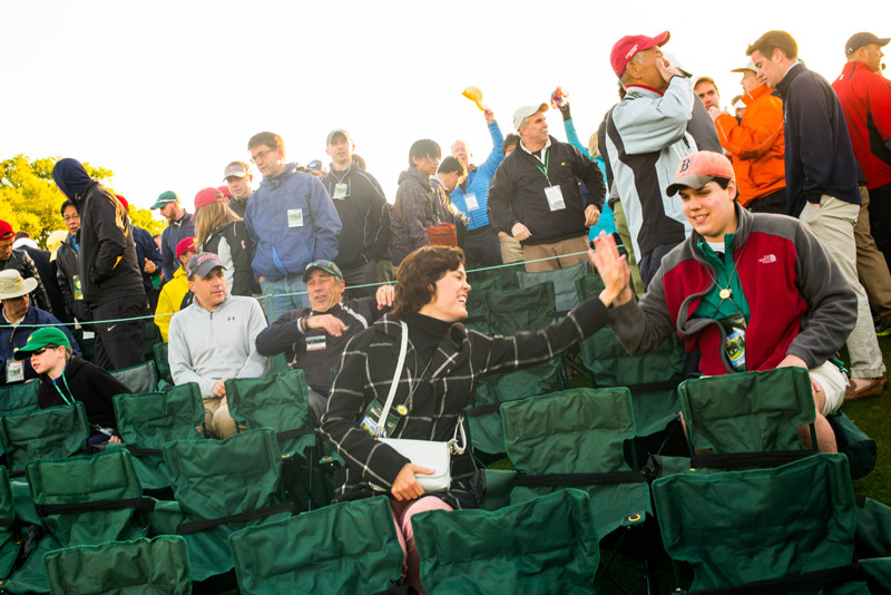 Haley and Hudson Allen of Athens, Georgia, congratulate each other on their seating arrangements early Sunday morning at the 18th hole prior to the final round of the 2016 Masters.