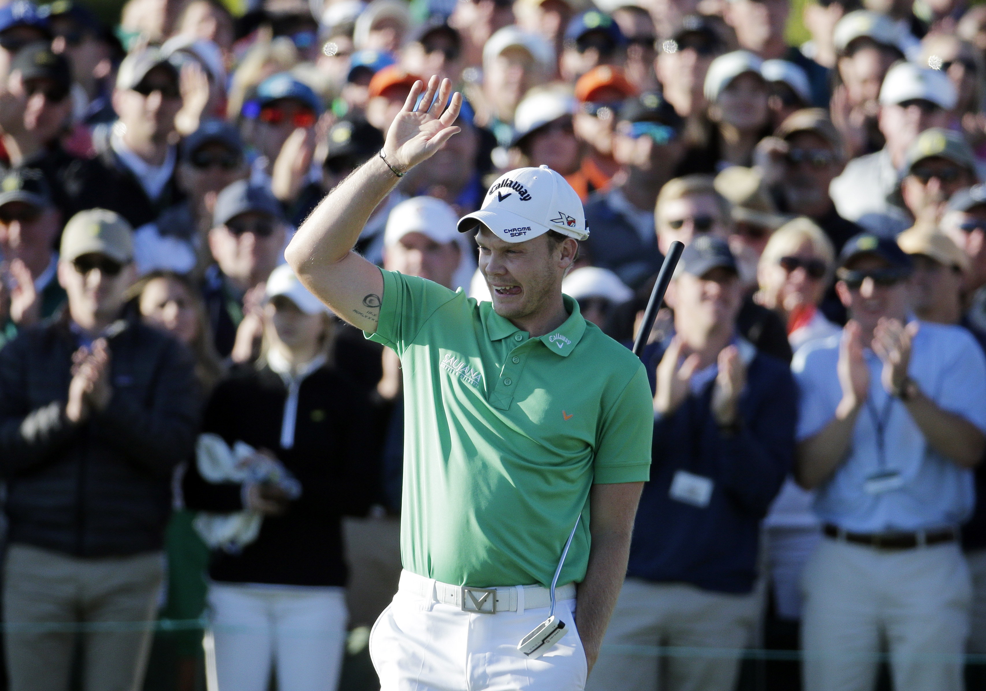 Danny Willett, of England, celebrates on the 18th hole after finishing the final round of the Masters golf tournament Sunday, April 10, 2016, in Augusta, Ga. (AP Photo/Charlie