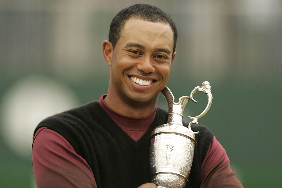 Tiger Woods lifts the Claret Jug after winning the 2005 British Open at the Royal and Ancient Golf Club in St. Andrews, Scotland.