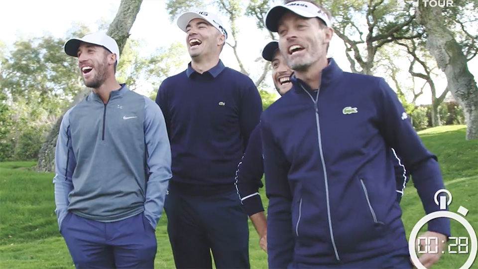 Members of the French relay squad look on as teams from Denmark and Spain attempt to break the Guinness World Record for fastest par-5 play.