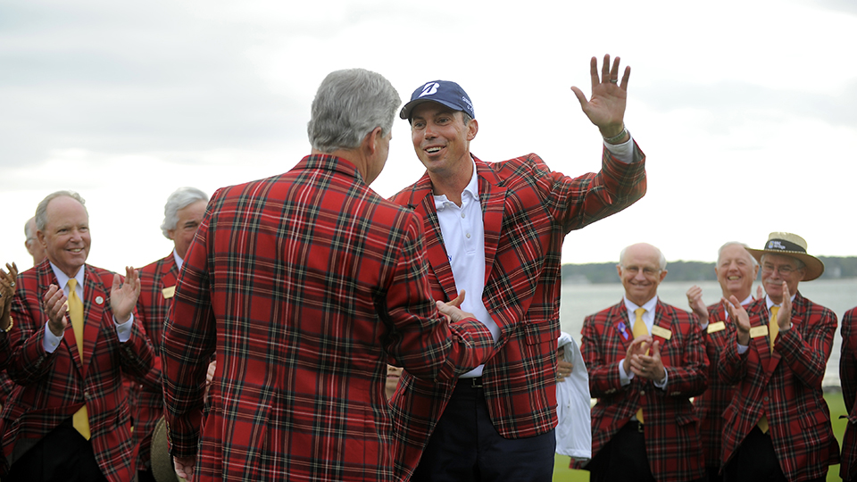 Matt Kuchar, center, received the plaid jacket from Jack Jones, vice president and general manager of Boeing South Carolina, after winning the final round of the 2014 RBC Heritage.