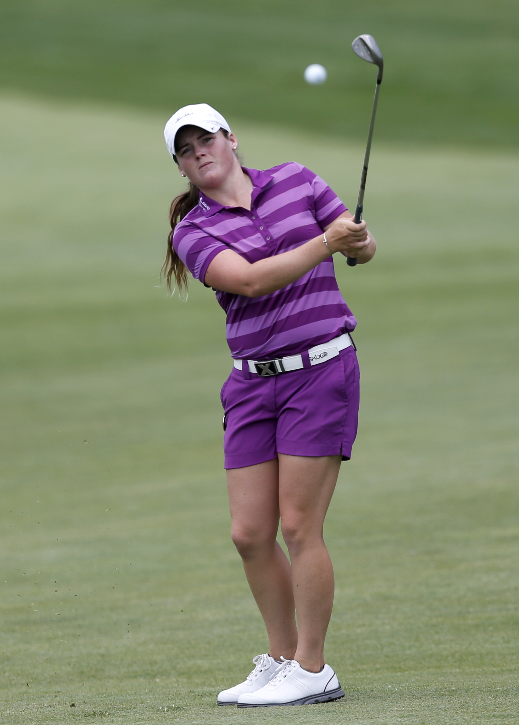 Katie Burnett chips on the 18th hole during the KPMG Women's PGA golf championship at Westchester Country Club, Thursday, June 11, 2015, in Harrison, N.Y. (AP Photo/Julio