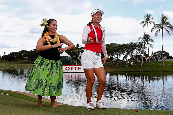 Minjee Lee of Australia dances the hula on the 18th green after winning the LPGA LOTTE Championship Presented By Hershey at Ko Olina Golf Club.