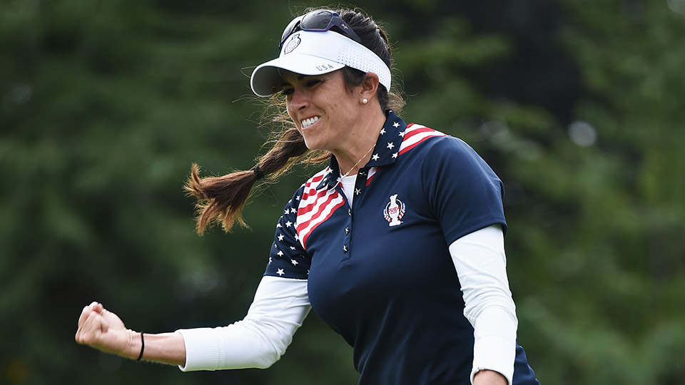 Gerina Piller celebrates winning her match during the singles matches of 2015 The Solheim Cup at St Leon-Rot Golf Club.