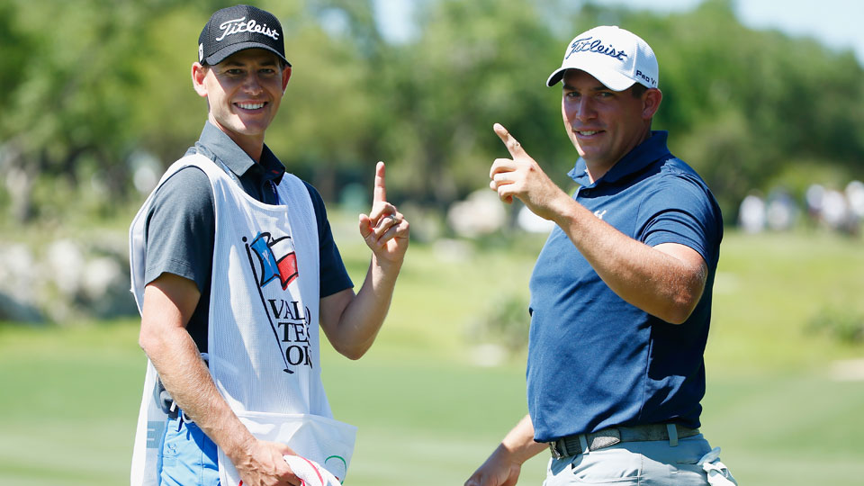Scott Stallings poses with his caddie after hitting a hole-in-one at the 2016 Valero Texas Open.