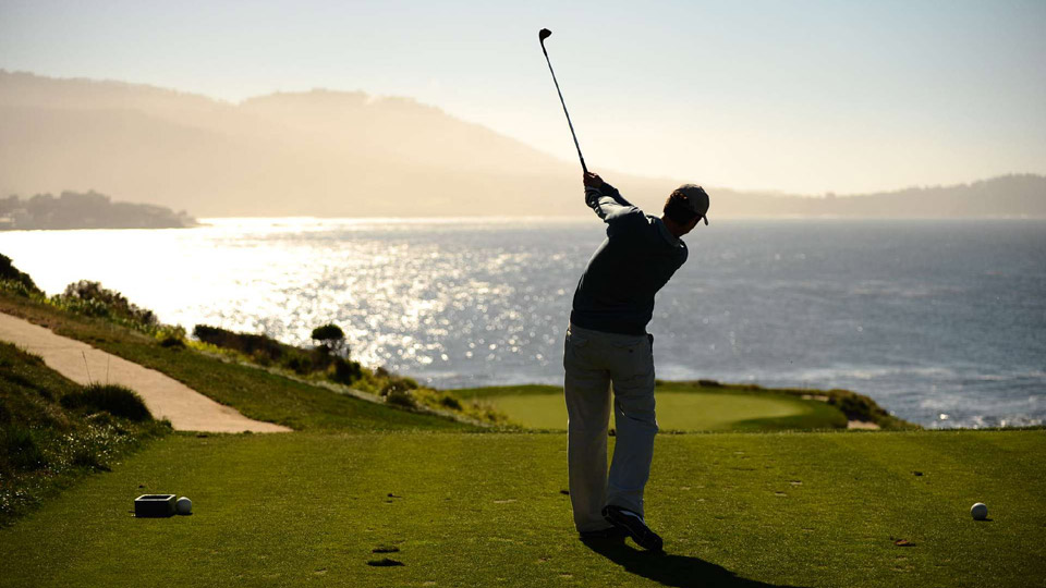 Alan Shipnuck tees off on the 7th hole at Pebble Beach.