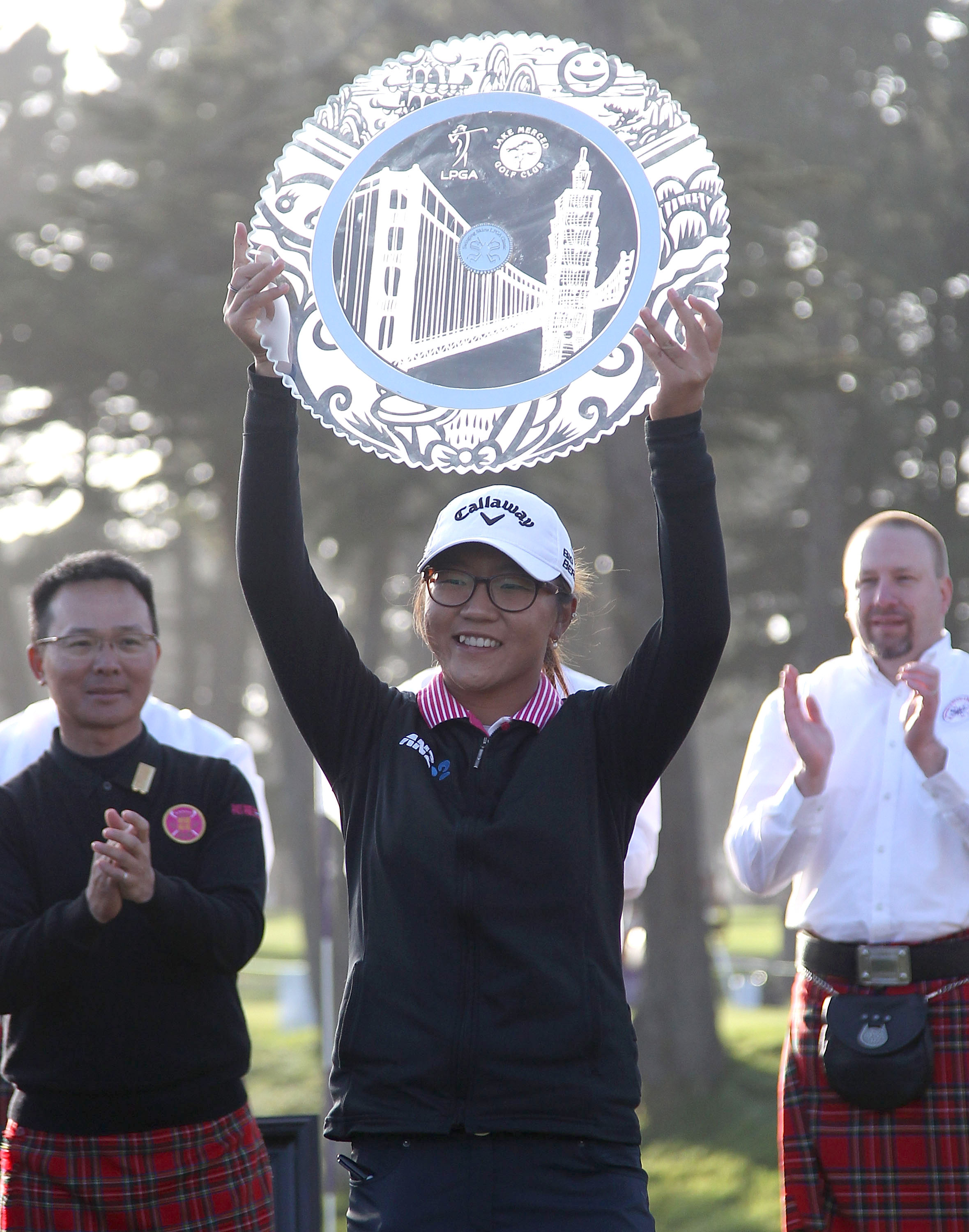 Lydia Ko raises the trophy after winning the Swinging Skirts LPGA Classic at the Lake Merced Golf Club on April 27, 2014, in San Francisco, California. It was her first win since turning professional.