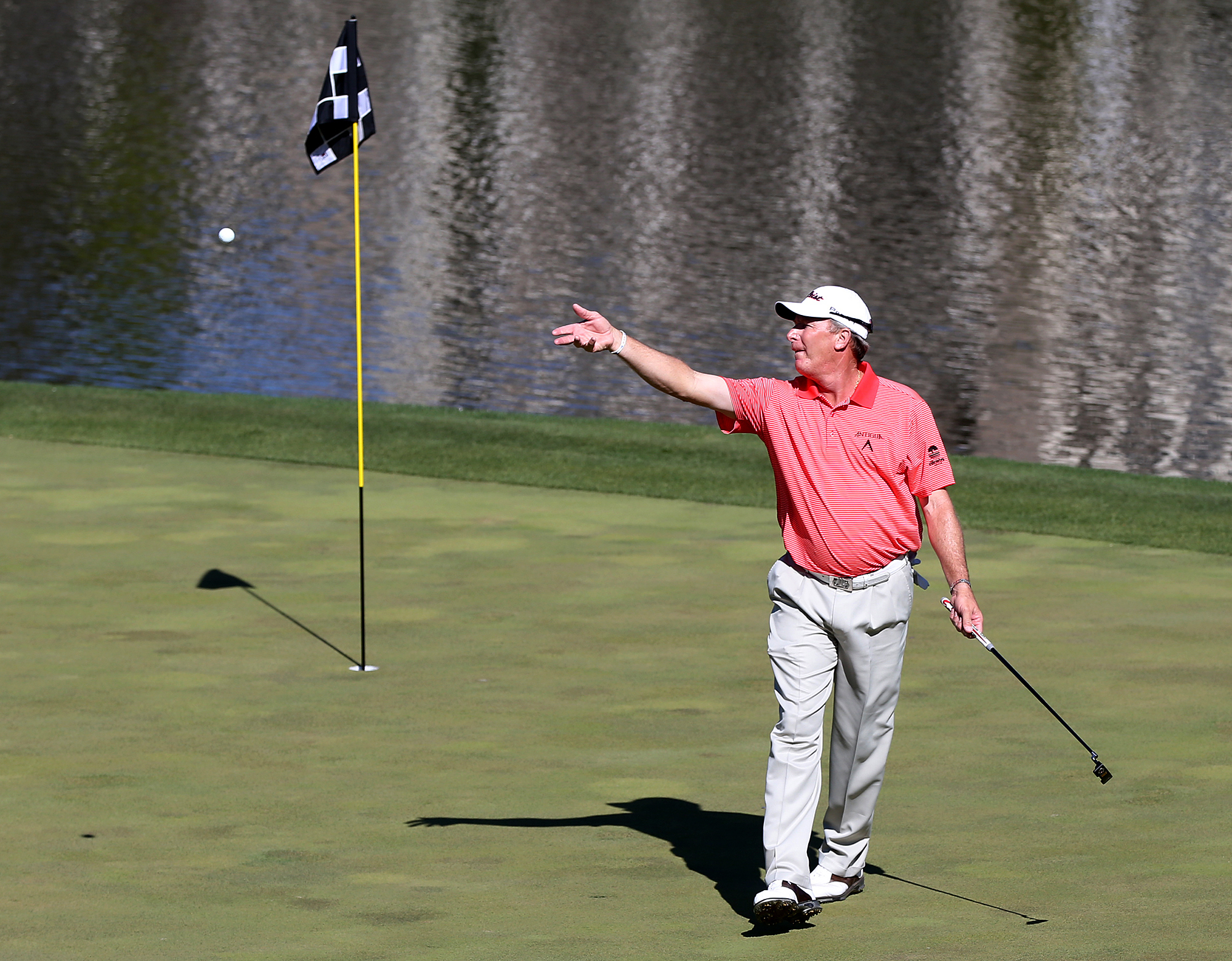 Woody Austin tosses his golf ball after making par on the 18th hole that resulted in a playoff with Wes Short Jr. during the PGA Tour Champions golf tournament at TPC Sugarloaf on Sunday, April 17, 2016, in Duluth, Ga. Austin tied the tournament record